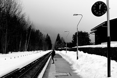 Waiting for the midday train (pascalcolin1) Tags: chamonix lepraz homme man gare station train neige snow brume mist photoderue streetview urbanarte noiretblanc blackandwhite photopascalcolin 50mm canon50mm canon