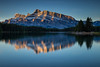 Rundle Mountain reflecting in Two Jack Lake in Banff National Park at sunrise. (tvrdypavel) Tags: alberta america autumn banff blue calm canada canadianrockies canadianrocky cloud clouds cold dawn exposure first forest green jack lake landscape light morning mountain mountains nationalpark nature north october orange outdoor park reflection reflections rocks rocky scenery scenic sky snow stone stones sunrise texture travel trees two view water white yellow