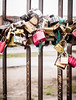 Lovers Padlocks Attached To A Gate On The Former Berlin Wall, Germany (Peter Greenway) Tags: berlinwall graffiti locks eastgermany germany loverslock togetherness gate barrier redlock security padlocks irongate metal love hope iconic flickr wall eastsidegallery