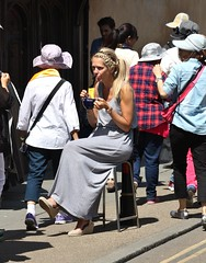 Canterbury High Street - June 2015 - Hot Chocolate with Braids (Gareth1953 All Right Now) Tags: beautiful mature woman girl sitting stool pavement canterbury kent blonde ponytail braids drinking hot chocolate mug long grey dress lostinthought meditating tanned watch wrist