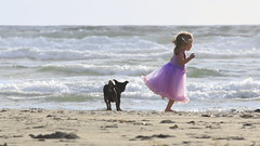 Childhood Joys (foreverfrozen12) Tags: seaside or oregon girl beach sand playing innocence dog childhood joy frolic
