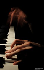 The Piano (disgruntledbaker1) Tags: piano hand blur white black