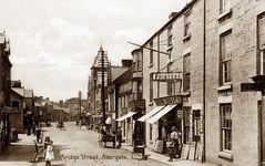 Bridge Street, Abergele (footstepsphotos) Tags: abergele bridgestreet road shop store people children wales old vintage postcard past historic
