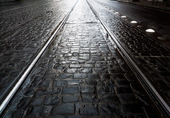 Street Rails to the Light (Orbmiser) Tags: mzuikoed1240mmf28pro 43rds em1 mirrorless olympus ore portland m43rds cobblestones bw rails lightrail max street