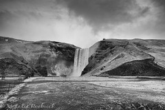 Skogafoss, Iceland (ambeizzi) Tags: explored iceland january south shore adventure reykjavic excursions monochrome black white waterfall rocks mountain skogafoss