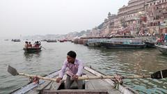 Varanasi boatman (Tim Brown's Pictures) Tags: india varanasi benares ganges river gangesriver religion hindu hinduism pilgrims travel color people boats uttarpradesh