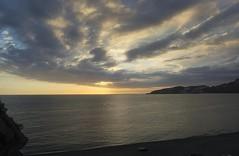 Tras la Tormenta (Tomás Hornos) Tags: playa beach roca peñón nubescloud sky cielo atardecer sunset puestadesol paisaje mediterráneo almuñécar