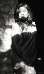 sunkissed (subhajyoti) Tags: portrait monochrome subhajyotiroychowdhury availablelight womaninasaree lightplay india kolkata