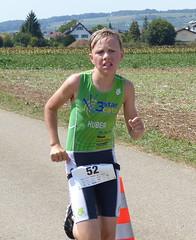 Determination (Cavabienmerci) Tags: triathlon 2017 neunkirch switzerland suisse schweiz kid child children boy boys run race runner runners lauf laufen läufer course à pied sport sports running triathlete earring earrings