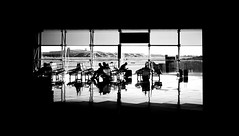 Flight Connection (elgunto) Tags: airport barcelona waiting connection flight planes people benches boredom time blackwhite bw silhouette highcontrast frame sonya7 sonyfe55mm18 zeiss