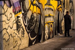 Watching the Watcher (www.karltonhuberphotography.com) Tags: 2018 alley brickwall citystreets dude frombehind graffiti karltonhuber man mural peoplewatching santaana shadows southerncalifornia streetphotography streetscene trenchcoat watching