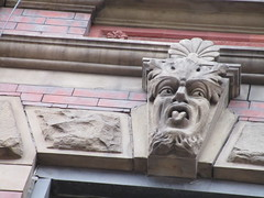 Green Man Tongue Out Gargoyle 6118 (Brechtbug) Tags: green man tongue out face gargoyle above window building facade 9th avenue west 52nd street nyc 01202018 new york city midtown manhattan 2018 gargoyles portraits monster portrait monsters creature faces spooky art architecture sculpture keystone mask brownstone brown stone capital january sneer sneering satyr