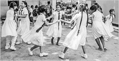 Ring a Ring o' Roses (Ramalakshmi Rajan) Tags: schoolkids kids uniform littlegirls children candid nikond5000 nikon nikkor18140mm blackandwhite blackwhite bw