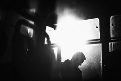 Weight 175.365 (ewitsoe) Tags: monochrome bnw blackandwhite flare silhouette dust canon eos 6dii tram window commuter pedestrian city urabn life living sun sunny cold winter warsaw poland polska