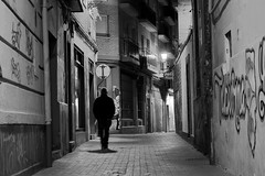 Shadows in the night (Daniel Nebreda Lucea) Tags: black white night noche city street calle urban urbano viejo antiguo antigua vieja ciudad alley callejon silueta silhouette man hombre walking andando solo light luz lights luces shadows sombras sombra dark darkness oscuro oscuridad fear miedo town pueblo canon 50mm 60d noir monochrome monocromatico bw
