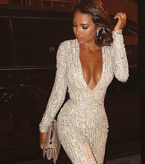 Nothing says show stopping glamour like a sequin jumpsuit. This look is smoking hot! See more at slay network