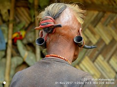 2017-09a India's Northeast (66d) (Matt Hahnewald) Tags: matthahnewaldphotography facingtheworld character head ears earlobe earpiercing hair hairstyle bareheaded consent rapport respect dignity travel culture custom anthropology ethnic tribal indigenous native minority rural traditional cultural warrior langwa nagaland northeast india asia naga indian asian oneperson male old man image picture photo illustrativeeditorial nikond3100 nikkorafs50mmf18g 50mm 4x3 horizontal street portrait closeup headshot backportrait outdoor color posing posingforcamera authentic serious shutterstock headhunter