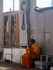 The good old humble Ethiopian monk (ybiberman) Tags: israel jerusalem citycenter ethiopianchurch monk old cane sitting clock portrait contemplating candid streetphotography people cross orange