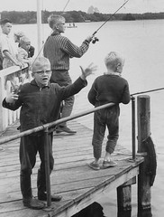It was this big (theirhistory) Tags: boys children kids adults pier jetty trousers jacket wellies rod lime fishing fish shoes fence barrier wellingtons