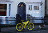Vintage & Retro - TM100389 (Ramarsh45) Tags: weymouth dorset jurassic coast harbour quayside bicycle bike yellow notice art gallery sign house door window iron railings pavement road letterbox knocker ring kerb wheels handlebars gears tyres cogs vintage retro reflections walls arch
