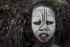 The white child (Paolo Cinque / www.paolocinque.it) Tags: kolcho village image shot flickr photographer photography masterpiece perfect nice cool great emotion eyes awesome stunning incredible beautiful world worldwide adventure visiting visit travelling traveling travelphotography traveler travel traveller ethnic people bodypainting ritratto retrato face portrait africa ethiopia african ethiopian karo tribes tribe poor child