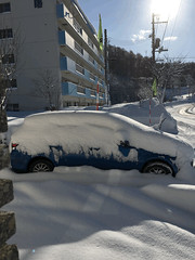 Animated Snowbank (sjrankin) Tags: 21february2018 edited snow snowbank weather road sidewalk sky clear car cars building gif animatedgif
