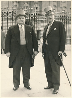 Two men in front of Buckingham Palace, London