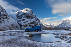 Almost a car advert... (sarahOphoto) Tags: 6d canon glencoe highlands kingdom scotland uk united unitedkingdom gb car advert thrifty mitsubishi warrior blue three sisters mountains snow pass glen coe vehicle ice cool rental reflection sky clouds landscape winter