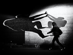 shadow on the wall (Sandy...J) Tags: atmosphere grafitti art urban noir blackwhite bw black white street streetphotography sw schwarzweis strasenfotografie monochrom shadow light licht darkness dark tunnel underpass walking walk fotografie photography olympus city stadt germany deutschland wall wand silhouette