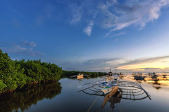 Stills (Lemuel Montejo) Tags: lake riverbank jetty pier river standing water boardwalk pond pedal boat tourboat idyllic sea bay panglao bohol sunset dusk golden blue