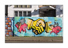 Street Art (Zandism), North West London, England. (Joseph O'Malley64) Tags: zandism streetartist streetart urbanart publicart freeart graffiti mural muralist art artist artistry artwork northwestlondon london england uk britain british greatbritain hordings woodenfencepanels door doorway woodendoor entrance exit barbedwire burglaralarms lamp lighting windows antitheft shutter rollershutter blockpaving stopcocks granitekerbing tarmac doubleyellowlines noparkingatanytime parkingrestrictions urban urbanlandscape aerosol cans spray paint fujix x100t accuracyprecision flyingpigs pigswillfly handshake