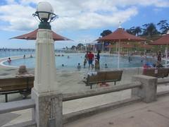 Swimming Pools, Geelong Waterfront (d.kevan) Tags: australia victoria waterfronts people seats streetlamps geelong trees parksandgardens playgrounds swimmingpools sunumbrellas