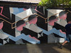 Black, Blue and Pink (Steve Taylor (Photography)) Tags: pipe globe shorts art graffiti mural streetart roof black blue green grey white man uk gb england greatbritain unitedkingdom london branch leaves