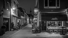 de Vijfhoek (McQuaide Photography) Tags: haarlem noordholland northholland netherlands nederland holland dutch europe sony a7riii ilce7rm3 7rm3 alpha mirrorless 1635mm sonyzeiss zeiss variotessar fullframe mcquaidephotography lightroom adobe photoshop tripod manfrotto stad city urban lowlight architecture outdoor outside illuminated street straat wideangle wideanglelens groothoek building longexposure oldstreet old oud character traditional authentic atmosphere sfeer light licht nightphotography night streetlight blackandwhite bw mono monochrome 169 widescreen vijfhoek cafedevijfhoek cafe bar wolstraat langeraamstraat hoek corner sign window raam