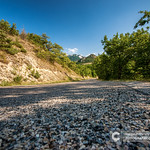 Long winding asphalt road through the mountains. thumbnail
