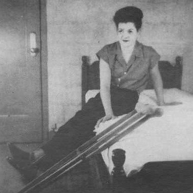 bed02 Fully braced polio girl getting off her bed