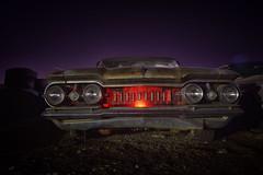 OLDSMOBILE (slammerking) Tags: oldsmobile classic vintage car automobile automotive longexposure slowshutterspeed night backlit nighttime junkyard salvageyard nikon red