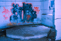 cafe (SO HIPP) Tags: cafe graffiti abandoned stage london ontario factory candy sugar colour tint lightroom lofi photoshop orange black chair seat alone still scary spooky