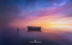 Explosion of colors at sunset (joana dueñas) Tags: sunset mediterraneansea joanadueñas photofeeling seascape tarragona deltadelebre longexposeture reflexes reflections clouds colorfull boat fishboat winter