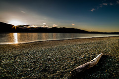 Desolate beach (Sean Greenland) Tags: beach desolate driftwood sunset night nz drifting nature natureshot natural nikon sky sun sunsets sunshine shore stones pebbles peak mountain mountains nightsky nightlight southisland beauty beautifal colours colour color colors