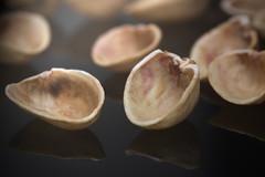 Empty Shells (Chancy Rendezvous) Tags: pistachio pistaccio shell shells seed husk empty used eaten food pistaciavera macro reflection