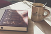 Lazy weekend with a book and coffee (theSpirea) Tags: book coffee mug vacation lazy chill weekend sunny bright reading literature classic table morning