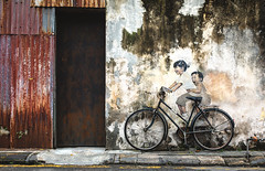Bike fun (Chris Herzog) Tags: ifttt 500px color street door house old pattern bicycle kids art fence brick fun wall bike alley entrance doorway painting corrugated penang malaysia asia george town