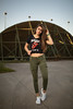 old military airport III (Michael Kremsler) Tags: model girl shooting portrait fashion streetfashion bellytop sneakers longhair jeans airport bunker concrete metal strobist evening summer brunette building bokeh