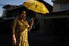 (AmirsCamera) Tags: phnompenh cambodia city urban asean asian lady woman person walking street streetphotography colour color yellow umbrella sunlight shadow olympus omdem1 omd november 2017