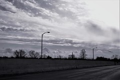 While Driving 1009 (Dimisahn) Tags: clouds sun sky bridge overpass lights street road highway motion movement black white