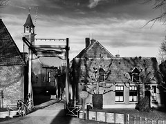 Back to the past (✦ Erdinc Ulas Photography ✦) Tags: monochrome old back past netherlands retro town village tower bridge dramatic panasonic clouds black white grey tree entrance nederland dutch holland clock roof house building stone traditional architecture zuiderzeemuseum museum zuiderzee enkhuizen