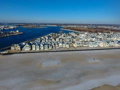 A snow-covered Manasquan Beach and the Atlantic Ocean, captured by a DJI Phantom 4 drone. (apardavila) Tags: atlanticocean djiphantom4 jerseyshore manasquan manasquanbeach manasquaninlet manasquanriver aerial beach beachfronthomes drone morning sky snow