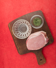 Pork fillet marinating mise en place. (annick vanderschelden) Tags: oil cookingoil herbs ingredients herbesdeprovence parsley thyme chives marjoram rosemary marinade board wood bowl glass decorative red food culinary