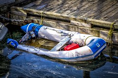 Yuck (Paul Rioux) Tags: marine boat vessel inflatable craft sinking deflated soft flooded dock wharf pier water ocean sea cowichan bay marina oil slick calm prioux zodiac